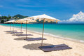 Beach umbrella on beach with blue sky Royalty Free Stock Photo