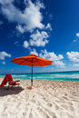 Beach umbrella and chair orange on the white sand in the shade beautiful sky Stock Photos