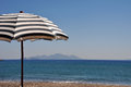 Beach umbrella gorgeous scene with greek at kefalos kos greece Stock Images