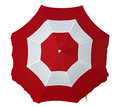 Beach umbrella with red and white stripes Royalty Free Stock Photo