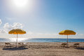 Beach umbrellas and chairs Royalty Free Stock Photo