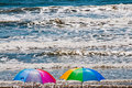Beach Umbrellas and Crashing Ocean Waves Royalty Free Stock Photo