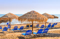 Beach umbrellas cyprus with thatched on the shore of the island of Royalty Free Stock Images