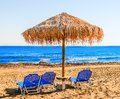 Beach umbrellas cyprus with thatched on the shore of the island of Royalty Free Stock Photography