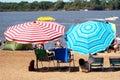 Beach umbrellas on sandy coast Royalty Free Stock Photography