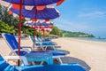 Beach umbrellas and sunbath seats on Phuket sand beach Royalty Free Stock Photo