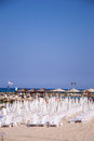 Beach umbrellas and sunbeds on the sand tel aviv Stock Photography