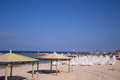 Beach umbrellas and sunbeds on the sand tel aviv Royalty Free Stock Photo