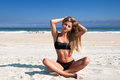 Beach vacation. Beautiful tanned woman in bikini  relaxing on the tropical beach Royalty Free Stock Photo