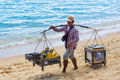 Beach vendor samui thailand march sells fruits and local food on the on march in samui thailand Stock Photos