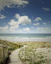 Beach view boardwalk leading to scenery Royalty Free Stock Photo