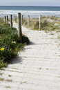 Beach view boardwalk leading to scenery Royalty Free Stock Image