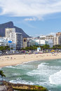 Beach view of leblon in rio de janeiro with christ redeemer statue in the background Royalty Free Stock Photo