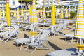 Beach view  with sunbeds and parasols on white sandy beach Royalty Free Stock Photo