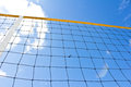 Beach volley net with a blue sky Stock Photos