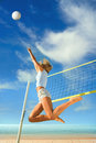 Beach volleyball jump up of sports young woman playing on sea Royalty Free Stock Photo