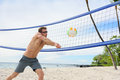 Beach volleyball man playing forearm pass hitting volley ball during game on summer male model living healthy active Stock Images