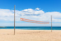 Beach volleyball net under a cloudy sky Stock Image