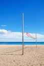 Beach volleyball net under a cloudy sky Stock Images