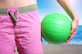 Beach volleyball player with ball green Royalty Free Stock Photography
