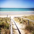 Beach walkway leading to scene Royalty Free Stock Photos