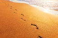 Beach wave and footprints this is Royalty Free Stock Photo