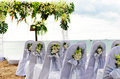 Beach wedding chairs and altar arranged on for with sea in background Royalty Free Stock Photos