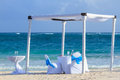 Beach wedding gazebo chairs and glasses set up for a romantic Stock Photography