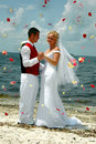 Beach wedding throwing flowers Stock Images