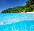 Beach with white sand bottom underwater view beautiful and above water split Stock Photography