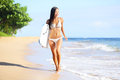 Beach woman fun body surfboard happy beautiful bikini model running beach looking sea summer vacation holidays mixed race asian Stock Photos