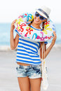 Beach woman happy and colorful wearing sunglasses and beach hat having summer fun during travel holidays vacation Royalty Free Stock Photo