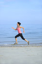 Beach woman running young fit asian seaside Stock Photos