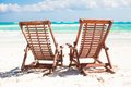 Beach wooden chairs for vacations and relax on tropical white sand in tulum mexico Royalty Free Stock Photography
