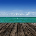 Beach with wooden plank Stock Images