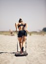 Beach workout woman pulling sled during a crossfit Stock Photography