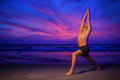 Beach yoga man warrior pose ocean Stock Photos