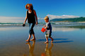 Mother Child Beachcombers with Red Bucket Royalty Free Stock Photo