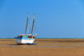 Beached boat a sailing at low tide on the beach of toliara madagascar Royalty Free Stock Photos