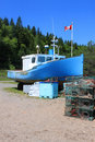 Beached boat in St. Martins, New Brunswick Stock Photography