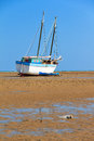 Beached sailing a boat at low tide on the beach of toliara madagascar Royalty Free Stock Photos