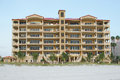 Beachfront condominiums beautiful condos in florida with fancy staircases with view of the white sandy beach Stock Image