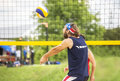 Beachvolley ball player forearm pass natural looking with stars and stripes bandana plays Stock Photo