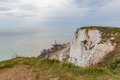 Beachy Head cliff  down to the lighthouse when the tide is out. Royalty Free Stock Photo