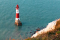 Beachy head lighthouse was built in the sea below east sussex it was m in height and became operational in october Stock Photography