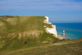 Beachy head uk circa april people hiking in seven sisters country park near the belle tout lighthouse uk circa april Stock Photography