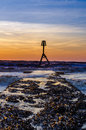 Beacon on bridlington south beach by dawn in september Royalty Free Stock Photos