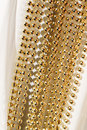 Beaded garland decor photo of shining golden Royalty Free Stock Photography