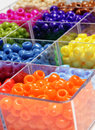 Beads for crafts jewelry closeup of in bins separated making Royalty Free Stock Photos