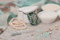 Beads jewelry on natural linen background hand made Royalty Free Stock Photo